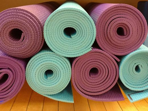 stack of rolled up yoga mats